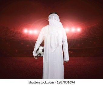 back side of Arab man  holding soccer ball, Arabic football concept.