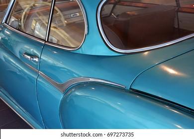 Back side of a blue vintage car