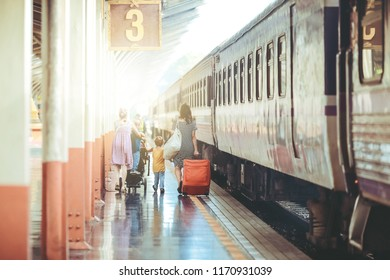 Back side of Multiethnic Travellers are looking the destination at the train station, Travel and transportation concept