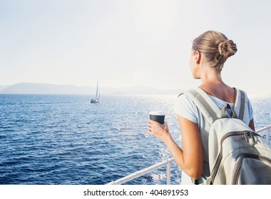 Back side of traveler girl looking at the sea, travel and active lifestyle concept