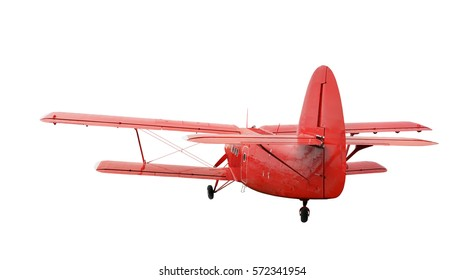 Back side view of red airplane biplane with piston engine and propeller. Isolated on a white background