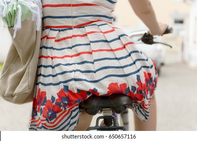 a back side view of a woman with a bicycle