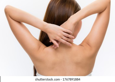 Back of slim young woman on white background.