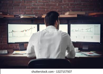 Back, spine view of trader man in work. Indoor, studio shot. Work, business , trade concept