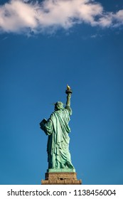 The back of the Statue of Liberty on a summer day.