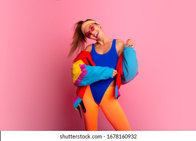 Back in time 90s 80s. Stylish girl in retro jacket and vintage aerobic body jump suit dancing, fashion trends, entertainment, heat in summer. Happy and positive.