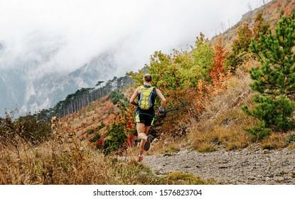 back trail running man run mountain marathon in autumn