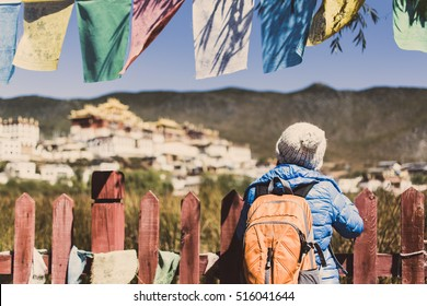 back of traveler girl/woman in front of songzanlin monastery