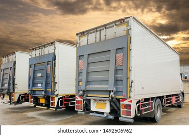 back a trucks with hydraulic lift parking at warehouse, freight industry logistics and transport