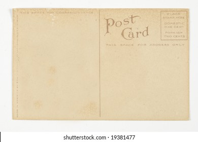 The back of a very old postcard turned brown with age.