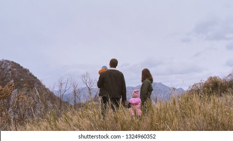 back view of active Family  with kids enjoying valley and mountain view in Montenegro