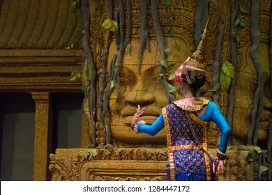 Back view of actress showing Khon dancing performance in Siem Reap, Cambodia. The UNESCO announced Khon, the Thai masked dance drama, and Lkhon Khol of Cambodia are intangible cultural heritage.