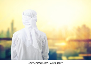 Back view of Arabic man proud of him self and looking away front of the sunrise, Business arabic concept