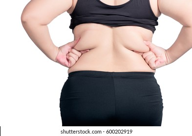 back view. asian fat women has overweight. she used hands squeezing excess fat of the waist. isolated on white background. she wants lose weight. concept of surgery and subcutaneous fat breakdown.