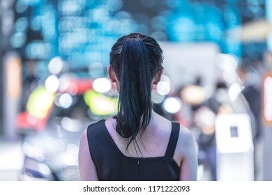 Back view of Asian female model