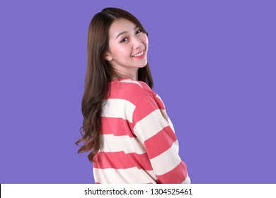 Back view of Asian woman smile, long sleeves t-shirt, purple background