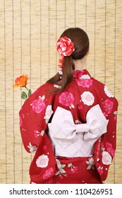 Back view of asian woman in traditional clothes of kimono