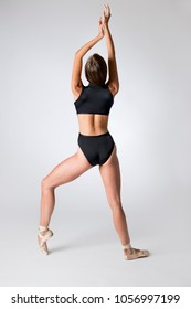 Back view of a ballerina wearing black dancewear