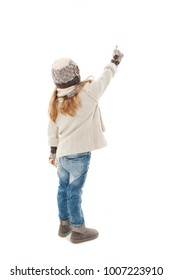 Back view of beautiful caucasian blonde  fashionable girl in warm clothes pointing up. Winter style. Isolated on white background.