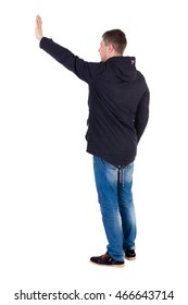 Back view of beautiful man welcomes. man hand waving from. Rear view  people collection.  backside view of person.  Isolated over white background. Man in warm jacket waving his right hand in greeting