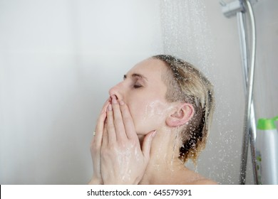 Back view of beautiful naked young woman taking shower