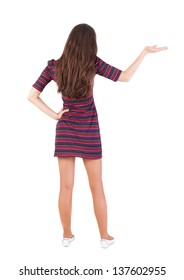 Back view of Beautiful woman in  dress looking at wall and Holds a hand up. Rear view people collection.  backside view of person.  Isolated over white background.