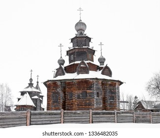 Back view of a beautiful wooden church in the snow