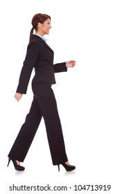 Back view of beautiful young business woman holding her hands up. Rear view. Isolated over white backrground