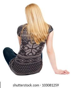 Back view of beautiful young woman sitting on the floor and looks into the distance. Blonde girl relaxes. Rear view people collection.  backside view of person.  Isolated over white background.