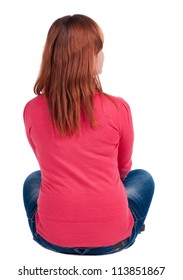 Back view of beautiful young woman in jeans sitting  and looks into the distance. Blonde girl relaxes. Rear view people collection.  backside view of person.  Isolated over white background.