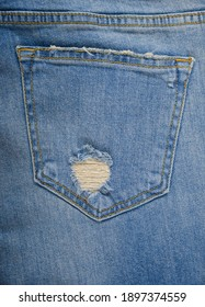Back view blue jeans with torn pocket and seams