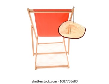 Back view of bright orange deck chair with straw hat hanging on it. Space for text.