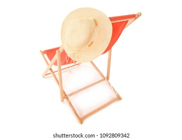 Back view of bright Orange Deckchair on a white studio background with a straw sun hat hanging from it. Space for text.