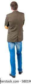 Back view of business man in jacket with patches on the sleeves .  looking ahead of yourself. Isolated over white background.