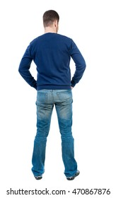 back view of Business man  looks.  Rear view people collection.  backside view of person.  Isolated over white background. bearded man in blue pullover standing with his hands in his trouser pockets.