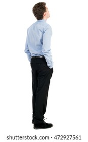 back view of Business man  looks.  Rear view people collection.  backside view of person.  Isolated over white background. The curly-haired businessman in light shirt stands with his hands in his