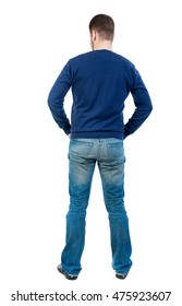 back view of Business man looks. bearded man in blue pullover standing with his hands in his trouser pockets.