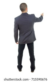Back view of a business man pointing finger, isolated