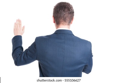 Back view of business man or politician standing raising hand taking oath  isolated on white background