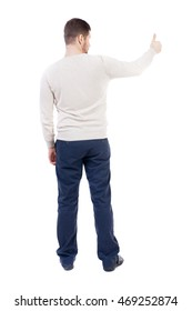 Back view of  business man shows thumbs up.   Rear view people collection. cheerful office worker shows positive emotions.  backside view of person.  Isolated over white background. The bearded man in