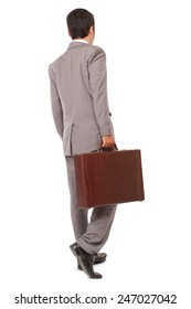 back view of a business man standing and holding a briefcase, isolated on white background