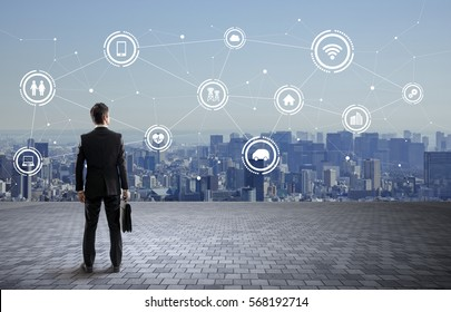 back view of business person and wireless communication network concept, Internet of Things, Smart City, Smart Grid, Information Communication Technology, abstract image visual