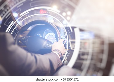 Back view of businessman at car wheel with abstract digital pattern. Future technologies concept