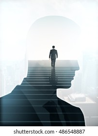 Back view of businessman climbing stairs and male head silhouette on light background. Success concept. Double exposure