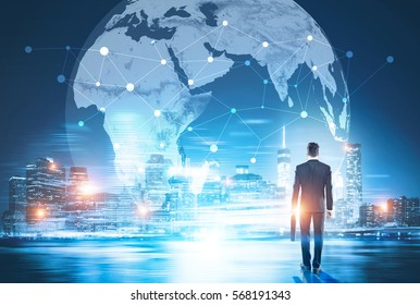 Back view of businessman in night city looking at globe with network. Global networking and international business concept