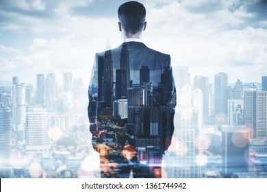 Back view of businessman on blurry bokeh city background. Success and confidence concept. Double exposure