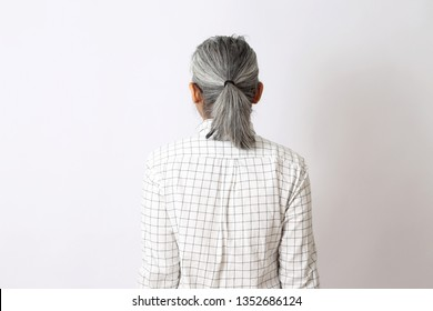 The back view of businessman on the white background.