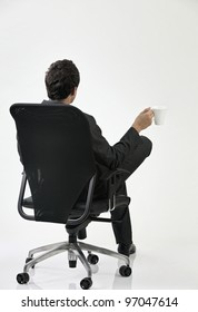 back view of the businessman sitting on the chair