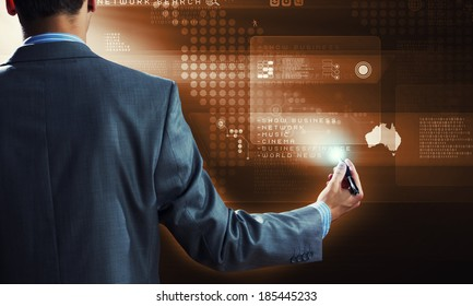 Back view of businessman touching icon of media screen