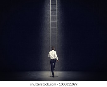 back view of businessman and very tall ladder